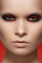 Close-up fashion model face with dark rock make-up Stock Images