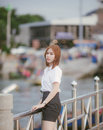 Close-up Fashion woman portrait of young pretty trendy girl posing at the bridge in Thailand,in university uniform Royalty Free Stock Photo