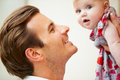 Close up of father holding baby daughter young Royalty Free Stock Images
