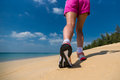 Close up of feet of a runner running in the beach training for marathon and fitness healthy lifestyle wellness concept Stock Photography