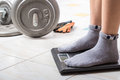 Close up female feet on digital weighting scale Royalty Free Stock Photo