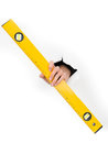 Close up female hand holding yellow spirit level white paper isolated Royalty Free Stock Images