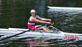 Close up of Female Sculler, Newark Club on the River Ouse at St Neots. Royalty Free Stock Photo