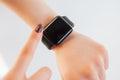Close up female touching screen of smart wrist watch Royalty Free Stock Photo