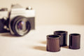 Close up of film rolls with retro photo camera Royalty Free Stock Photo