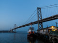 Close up of fire station and fireboat under san francisco bay bridge tied at dock in the at twilight Royalty Free Stock Photos