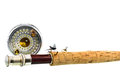 Close up of fly fishing rod and reel on white background Royalty Free Stock Photo