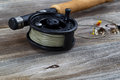 Close up of Fly Reel and Flies on Wood Royalty Free Stock Photo
