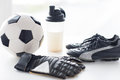 Close up of football boots, gloves and bottle Royalty Free Stock Photo
