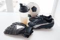 Close up of football, boots, gloves and bottle Royalty Free Stock Photo