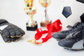 Close up of football, boots, gloves, cup and medal Royalty Free Stock Photo