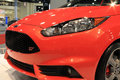 Close up ford fiesta st at miami auto show new bright hot orange on display stand international corner front side view starburst Royalty Free Stock Photo