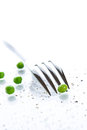 Close-up of fork and peas Stock Photos