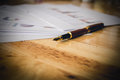 Close-up fountain pen on wood table. vintage tone filter effecte Royalty Free Stock Photo