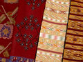 Close up of four hanged colourful handmade traditional wool rugs Royalty Free Stock Photo
