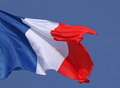Close up of french flag over blue sky Royalty Free Stock Photos