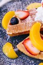 Close up Fresh baked Pancakes topping with strawberry, orange, blueberry and whip cream Royalty Free Stock Photo