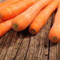 Close up of fresh carrots on a wooden table nutritive source vitamin and beta carotene Royalty Free Stock Images