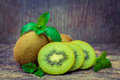 Close up fresh kiwi fruit on old wood background is sweet and sour taste nutritive value and high fiber selective focus Royalty Free Stock Image