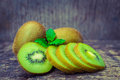 Close up fresh kiwi fruit on old wood background is sweet and sour taste nutritive value and high fiber selective focus Royalty Free Stock Photos