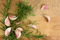Close up fresh organic garlic and rosemary from above Royalty Free Stock Images