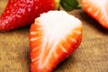 Close up on a fresh red strawberry with sugar Stock Photos