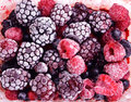 Close up of frozen mixed fruit berries red currant cranberr cranberry raspberry blackberry bilberry blueberry black Stock Photos