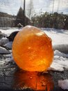 A close up of a frozen orange ball of ice Royalty Free Stock Photo