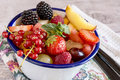Close-up of fruit and berries in bowl on table Royalty Free Stock Photo
