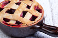 Close up fruit pie in clay pot Stock Photos