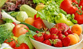 Close up fruits and vegetables in a bowl Stock Photography