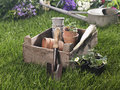 Close up of gardening equipments in a lawn on cyan blue tint Royalty Free Stock Images