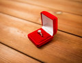 Close up of gift box with diamond engagement ring Royalty Free Stock Photo