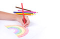 Close-up of girl drawing a rainbow Royalty Free Stock Photos
