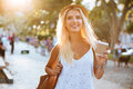 Close up of girl in hat holding take away cup Royalty Free Stock Photo