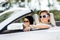 Close up of girls in sunglasses in the car wearing little holiday trip friends Stock Photo