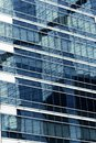 close up glass modern business office building and reflecion of Royalty Free Stock Photo