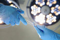 Close-up of gloved hands passing the surgical scissors, operating room, hospital Royalty Free Stock Photo