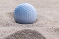 Close up golf ball in sand bunker . Royalty Free Stock Photo