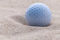 Close up golf ball in sand bunker. Royalty Free Stock Photo