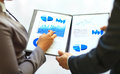 Close up of graphs and charts analyzed by business people Stock Images
