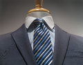 Close up gray striped jacket blue striped shirt tie Stock Image