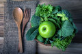 close up green apple with mixed green vegetable in  basket and w Royalty Free Stock Photo
