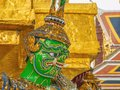 Close up Green Giant Lift golden Pagoda in Wat Phrakaew temple Bangkok Thailand