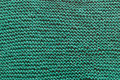 A close-up of a green knitted sweater.