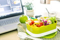 Close up green Lunch box on the work place of working desk ,Heal Royalty Free Stock Photo