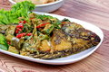 Close up of green tilapia fish curry in coconut milk. .Selective focus. Royalty Free Stock Photo