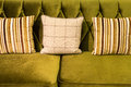Close up of green velvet sofa and cushions Royalty Free Stock Photo