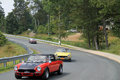Close up of group of classic italian sports cars on road fiat spider at event in wintergreen virginia closer Stock Photo