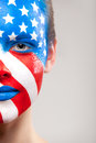 Close up of half side painted face flag usa is Stock Photo